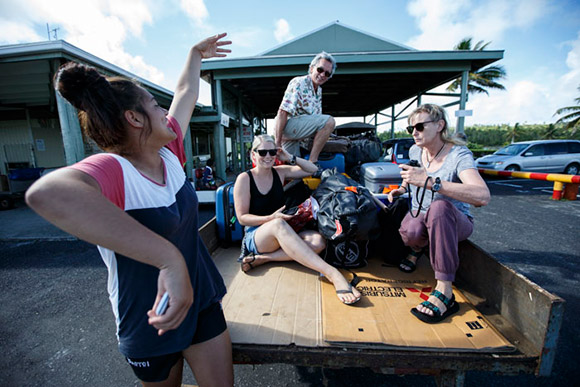 Irene, Tom and Sally hitching a ride in an Aitutaki ute.